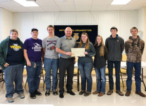 Above: Members of the Christ Our Savior FFA chapter accept the gift from Jacob Fishbein (FCI)